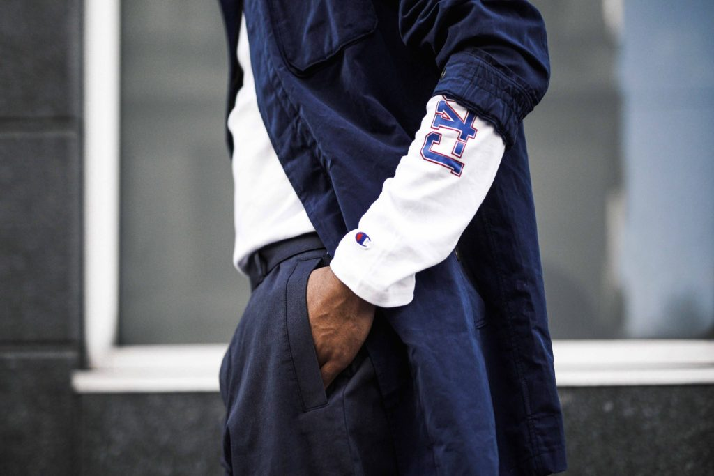 Jean-Claude Mpassy wearing Champions X Beams Shirt