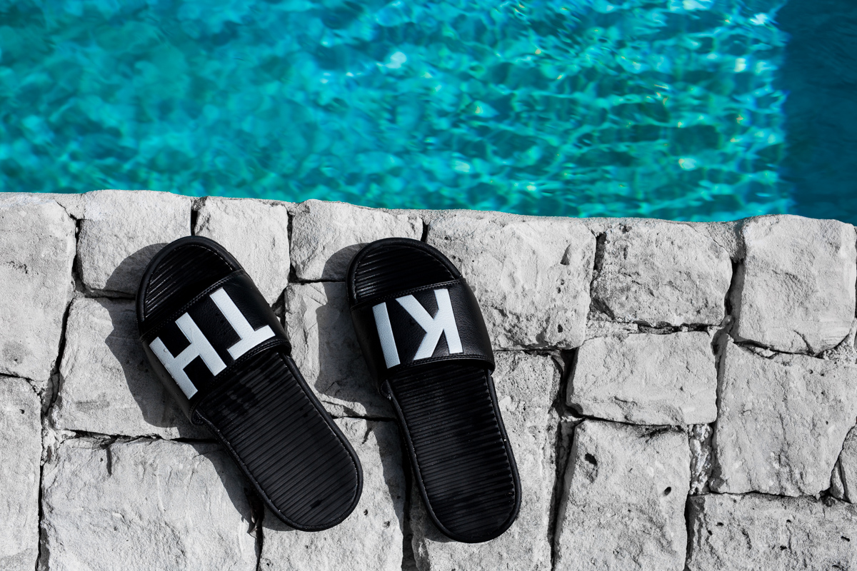 Kith Sandals laying at the Tiamo Resort on the Bahamas