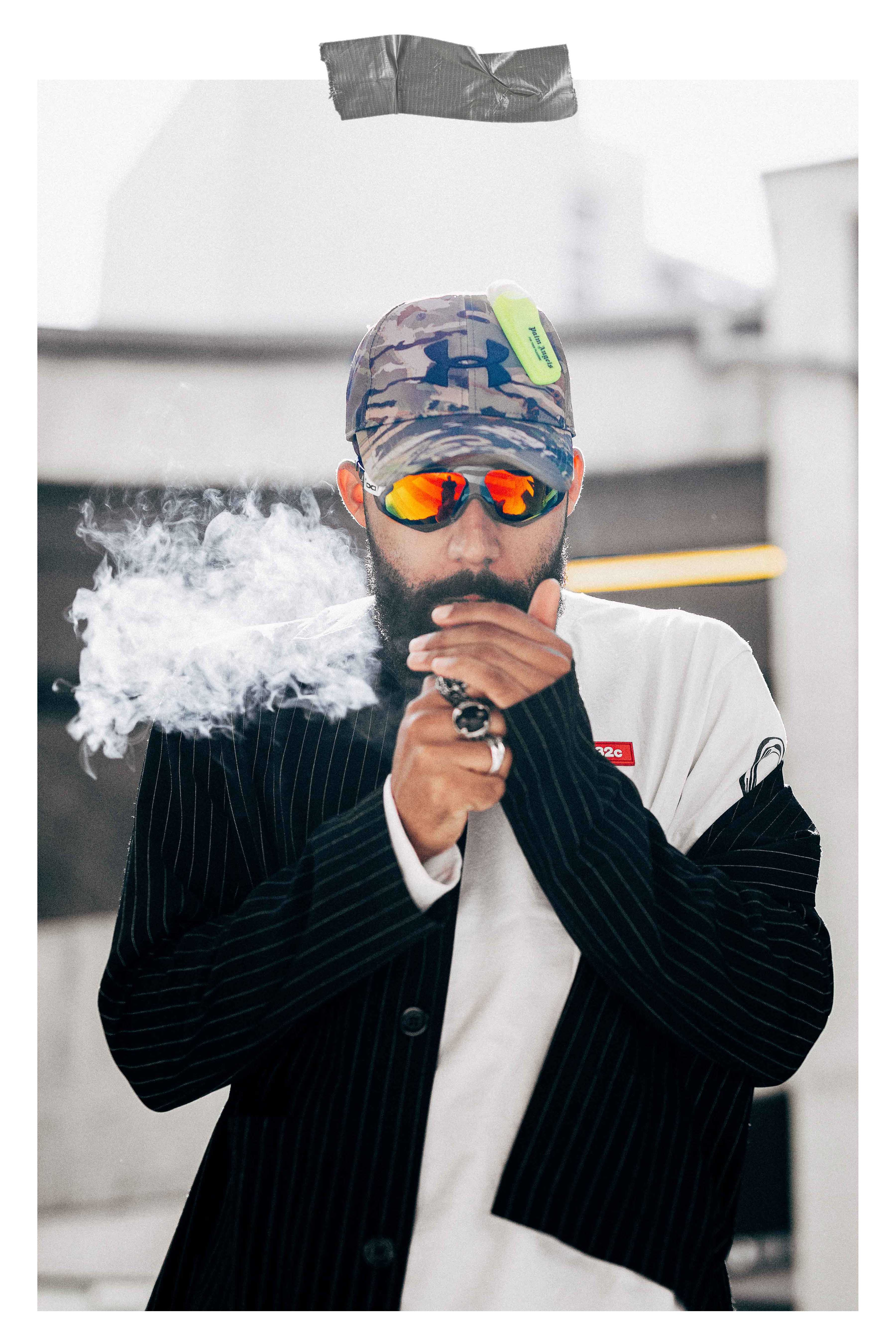 Jean-Claude Mpassy from New Kiss on the Blog wearing Under Armor X Palm Angels Cap adnd Gloryfy sunglasses