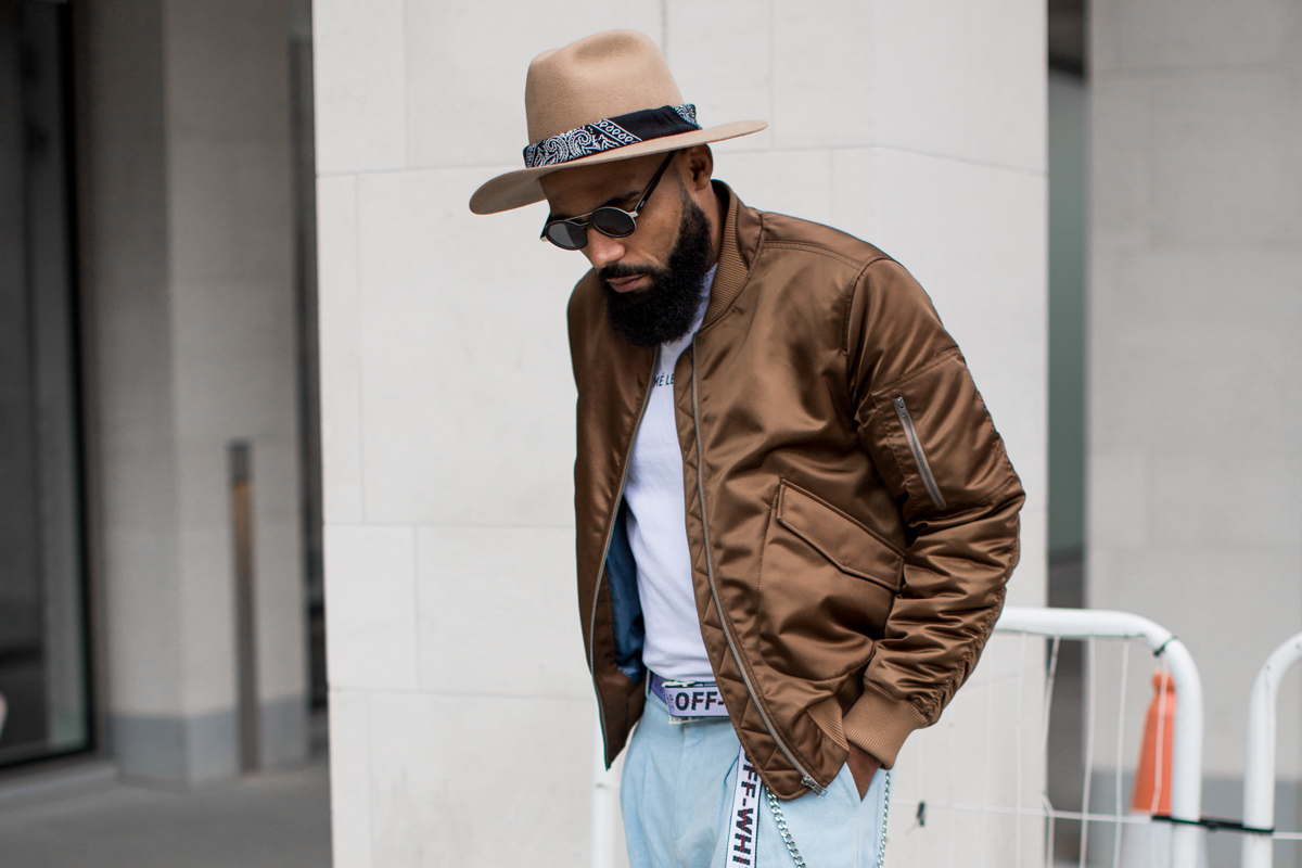 Street Style Photo of Jean-Claude Mpassy wearing Tiger of Sweden Jacket