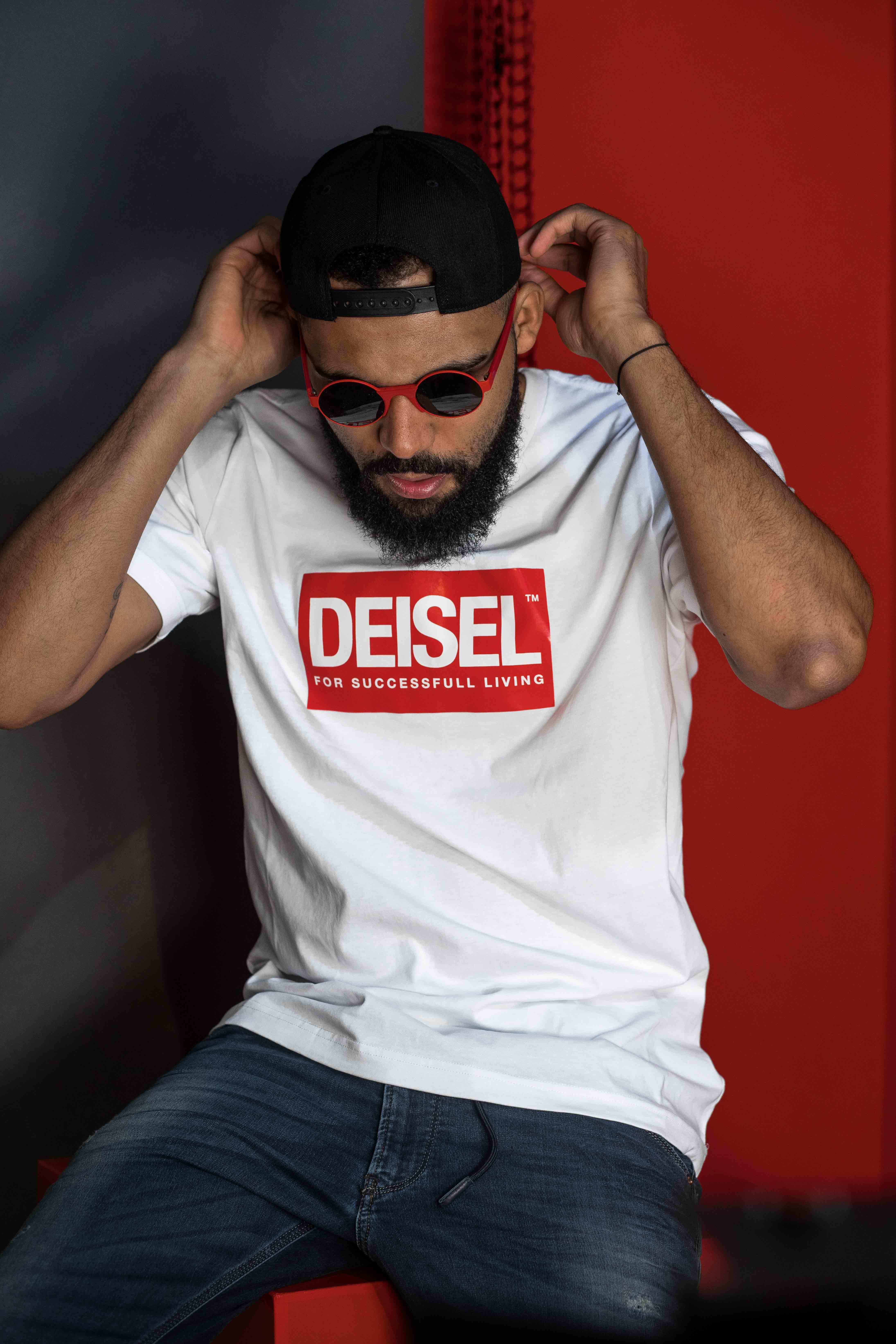 Blogger Jean-Claude Mpassy from New Kiss on the Blog wearing Diesel Fake Brand Deisel