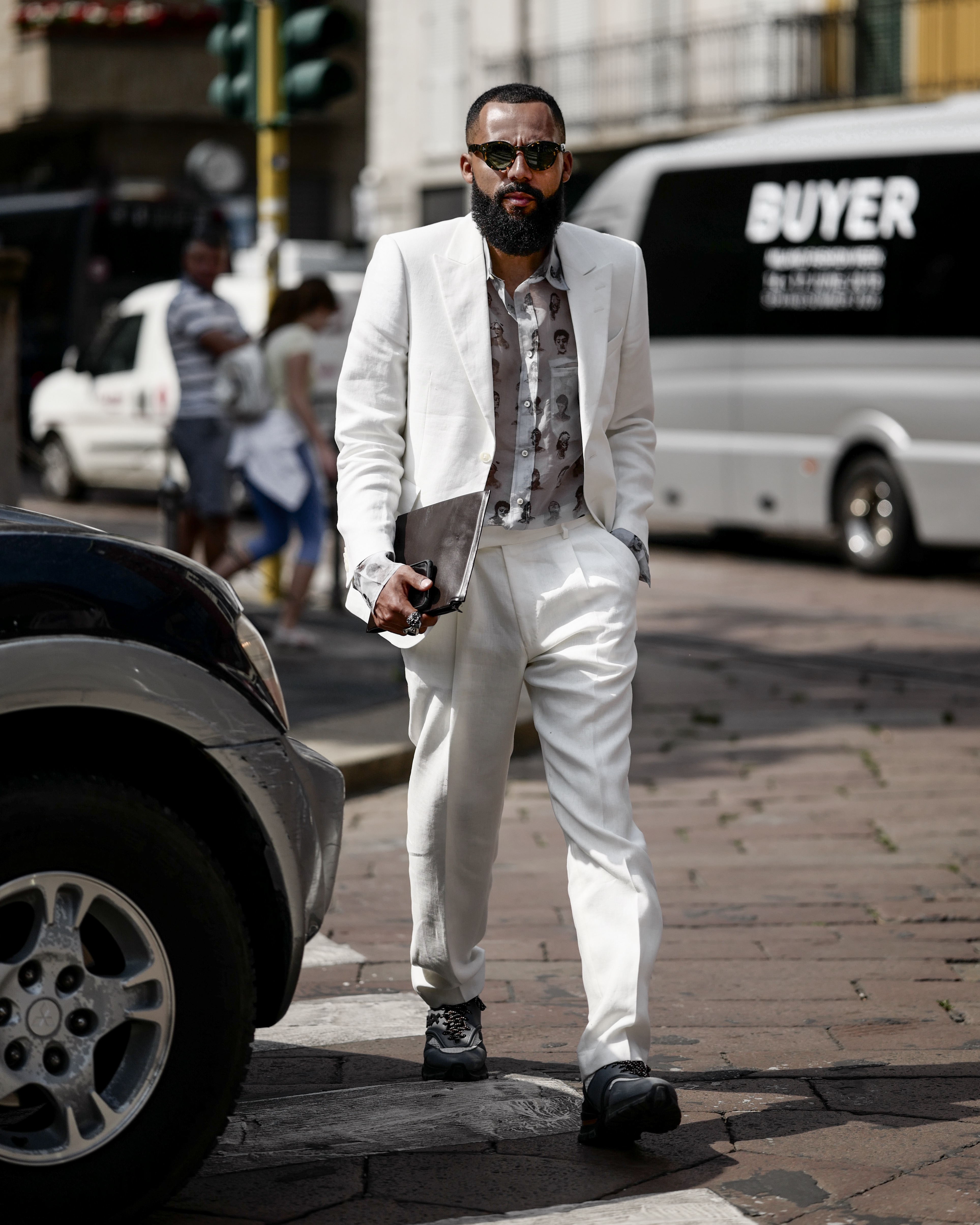 Street Style Shot of Jean-Claude Mpassy from New Kiss on the Blog during Milan Fashion Week. Wearing all-white Tiger of Sweden suit.